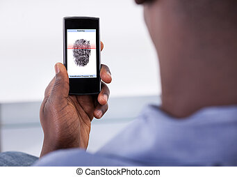 Person Holding Mobile Phone Showing Application With Process Of Scanning Fingerprint On A Screen