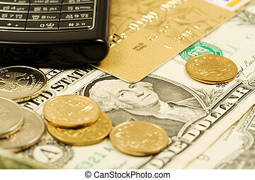 Mobile phone, credit card and cash. Financial background....