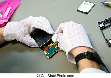 Mobile phone during the reparation by technician