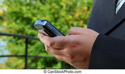 mobile phone in male hand
