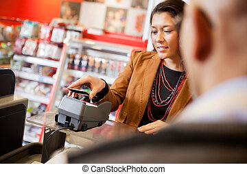Mobile Phone Payment Using NFC - Customer paying for...