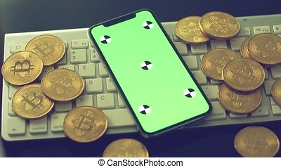 Mobile phone with gold bitcoins - Smartphone with chromakey...