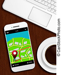 mobile phone with gps application, laptop and coffee lying od de