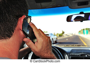 Mobile phones and driving - Concept photo of a male driver...