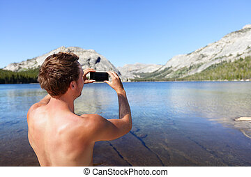 Mobile photographer taking picture with smartphone