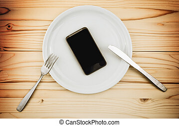 Mobile smart phone served as dinner on white plate. Concept ...