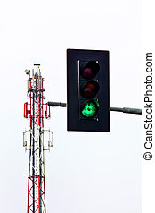 mobile transmission tower and green traffic light