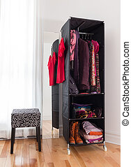 Mobile wardrobe with clothing and shoes - Mobile wardrobe...