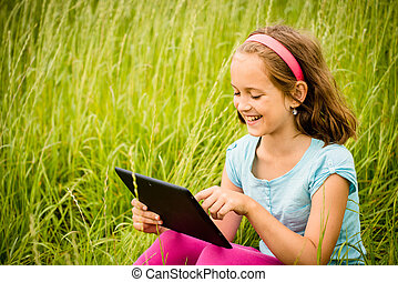 Mobility - child with tablet outdoor