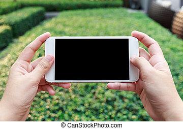 mobiltelefon, närbild, kvinna, hålla ögonen på, hand, video, holdingen