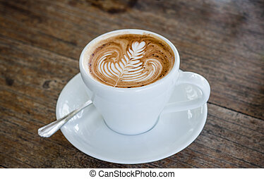 Mocha coffee  - Close up cup of mocha coffee on wood table