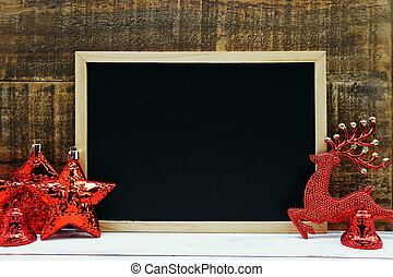 Mock up blackboard with Christmas decoration on wooden background