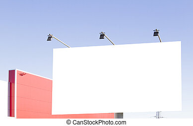 Blank billboard in the city against blue sky