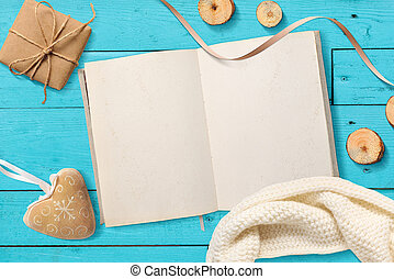 Mock up Blank open Notepad, Christmas gifts on a turquoise wooden background with space for your text