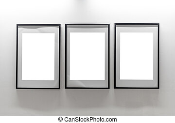 Mock up. Blank picture frames on white wall. Gallery wall with empty frames indoor