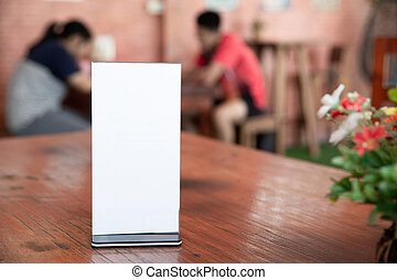 Mock up Menu frame on Table in Bar restaurant-cafeteria, Stand for booklets with white sheets of paper acrylic tent card, can be used for montage or display
