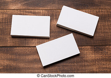 Mock up of business cards on wood background