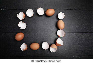 Mock-up of many eggs putted in frame on the table for cooking. Baking ingredients on wooden table. Space for text.