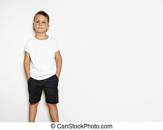 Mock up of young kid showing some action on the white background and wearing white shorts