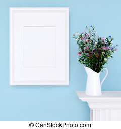 Mock up poster and wildflowers on a dresser with blue wall -...