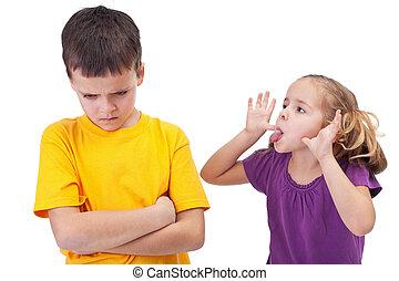 Mocking and teasing among children - girl taunting upset...