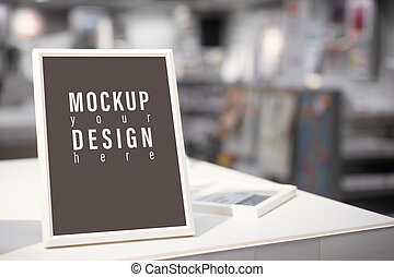 Mockup blank picture frame template for Photo or picture painting art gallery in living room at night on the table.