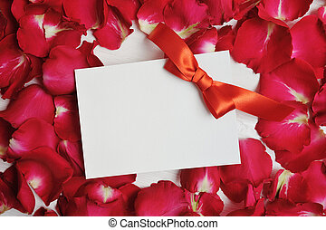 Mockup Card on red rose petals for Valentine's Day. Flat lay, top view with a place for your text