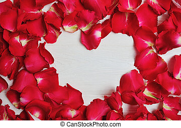 Mockup Card red rose petals in the shape of heart for Valentine's Day. Flat lay, top view with a place for your text