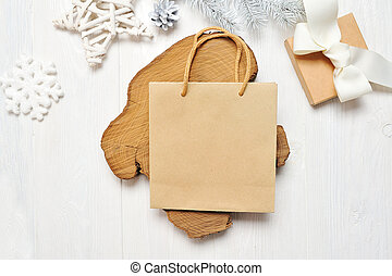 Mockup Christmas craft package and gift, flatlay on a white wooden background, with place for your text