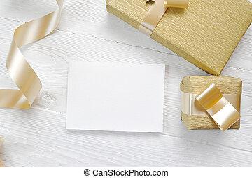 Mockup Christmas greeting card with gold gift ribbon, ...