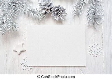 Mockup Christmas greeting card with white tree and cone, flatlay on a white wooden background, with place for your text