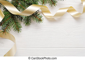 Mockup Christmas tree and gold ribbon, flatlay on a white wooden background, with place for your text