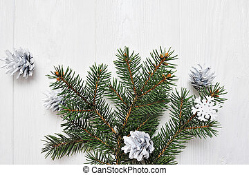 Mockup Christmas tree branch flatlay on a white wooden background, with place for your text
