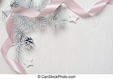 Mockup Christmas tree cone and pink ribbon, flatlay on a white wooden background, with place for your text