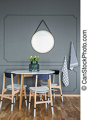 Mockup in grey dining room - Mockup of round mirror on grey...