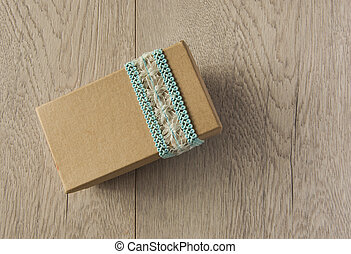 mockup kraft gift boxes with ribbon on wooden background