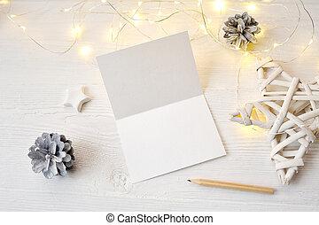 mockup, natale, cartolina auguri, vista superiore, flatlay, su, uno, bianco, legno, fondo, con, uno, ghirlanda