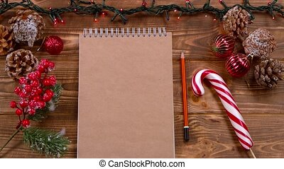 Mockup Notebook and pencil lie on the table, Christmas toys...