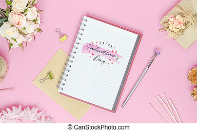 Mockup Notebook on pink background with Happy valentines day, roses bouquet, gift box, handy craft and pen. Mock up for elegant design with space for text.