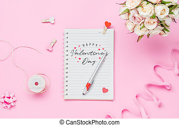 Mockup Notebook on pink background with Happy valentines day, roses bouquet, handy craft and pen. Mock up for elegant design with space for text.