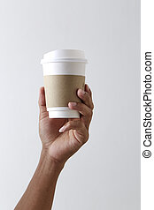 Mockup of male hand holding a coffee paper cup
