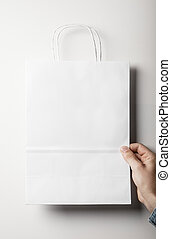 Mockup of white papaer bag