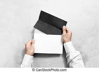 mockup, plié, enveloppe, main, prospectus, noir, tenue, vide