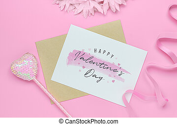 Mockup postcard and envelope on pink background with Happy valentines day, handy craft and pen. Mock up for elegant design. Flat lay top view valentine's day background.