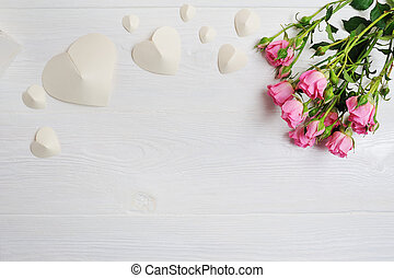Mockup white origami hearts made of paper with pink roses, card for Valentine's Day. Flat lay, top view with a place for your text