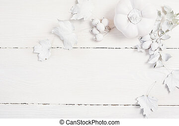 Mockup white pumpkin, berries and leaves on a wooden autumn background. Greeting card for Thanksgiving Day in rustic style with space for your text. Flat lay. Top view