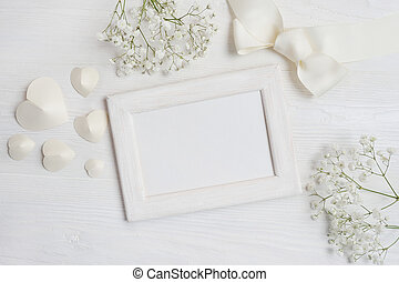 mockup white wooden frame with hearts and flowers and bow card for St. Valentine's Day in rustic style with place for your text, Flat lay, top view photo mock up