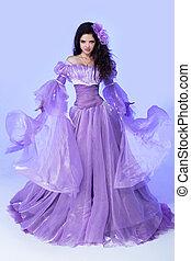 moda, joven, magnífico, mujer, en, violeta, soplar, dress., foto del estudio