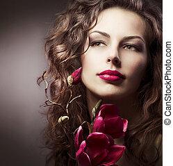 moda, mujer, con, magnolia, primavera, flowers., toned sepia
