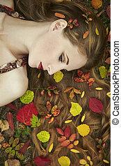mode, stående, av, a, vacker, ung kvinna, in, höst, trädgård